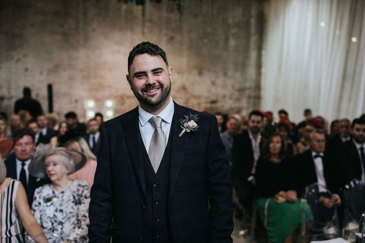 Groom at the Altar
