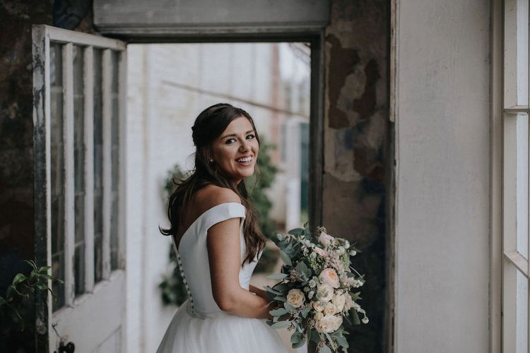 Beautiful Bride in Off the Shoulder Suzanne Neville Gown  and Wedding Bouquet