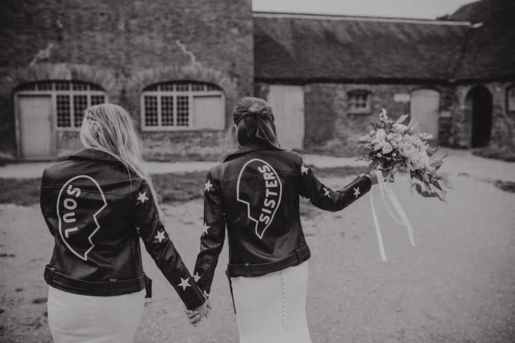 Bride and Bridesmaid in Leather Jackets with Soul Sister Written on the Back