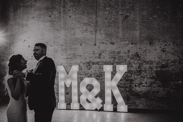 Bride and Groom First Dance in Front of Giant Light Up Letters