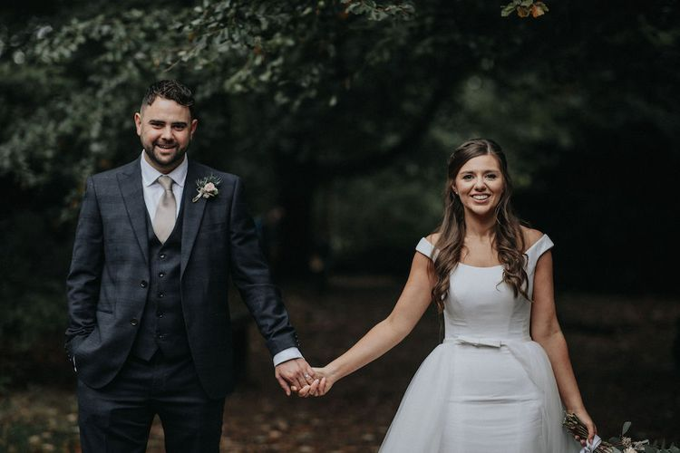 Bride and Groom Holding Hands Wedding Picture