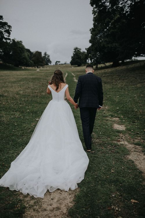 Bride and Groom Walking through the Countryside