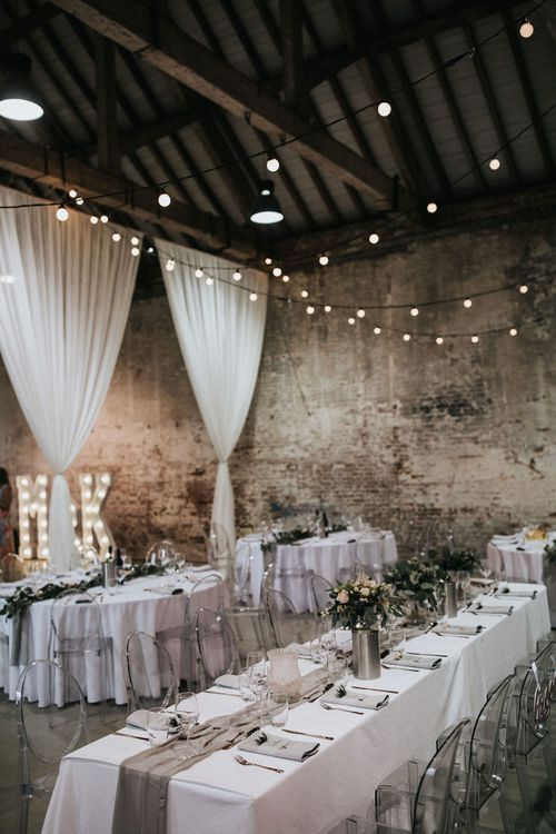 Wedding Reception Decor with Drapes, Marquee Letter Lights, Festoon Lights and Ghost Chairs
