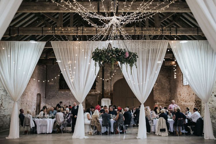 Fairy Light Canopy and Floral Chandelier Wedding Reception Decor