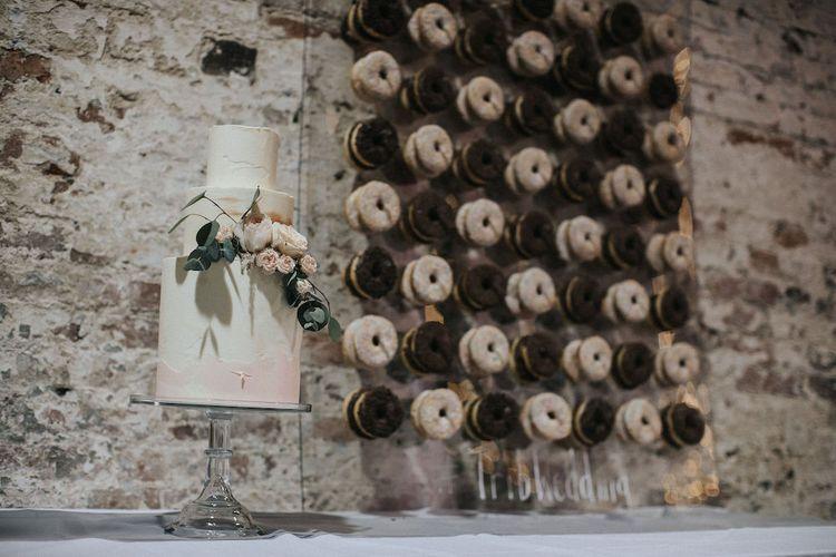 Elegant Wedding Cake and Doughnut Wall