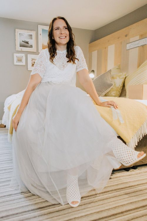 Bride on wedding morning with block heel sandals and blue tulle skirt