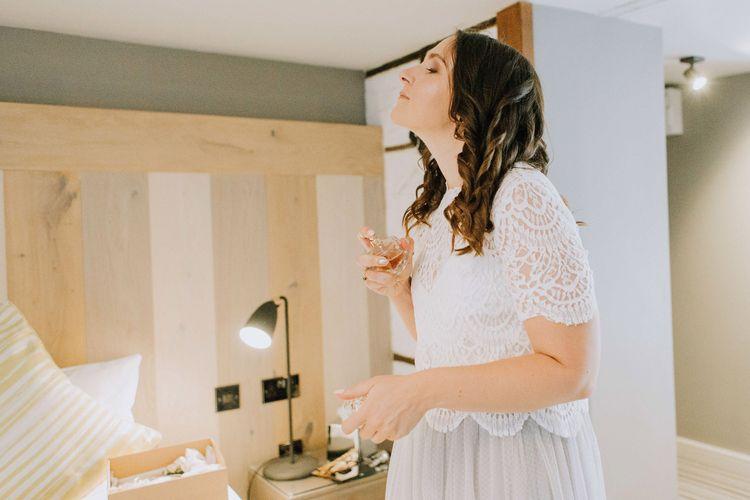 Bride on wedding morning putting on perfume