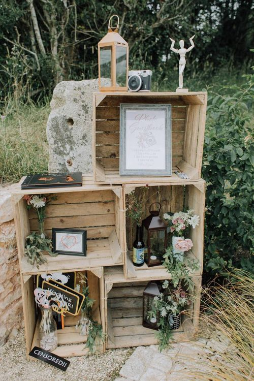 Wooden crate wedding decor with flowers and lanterns