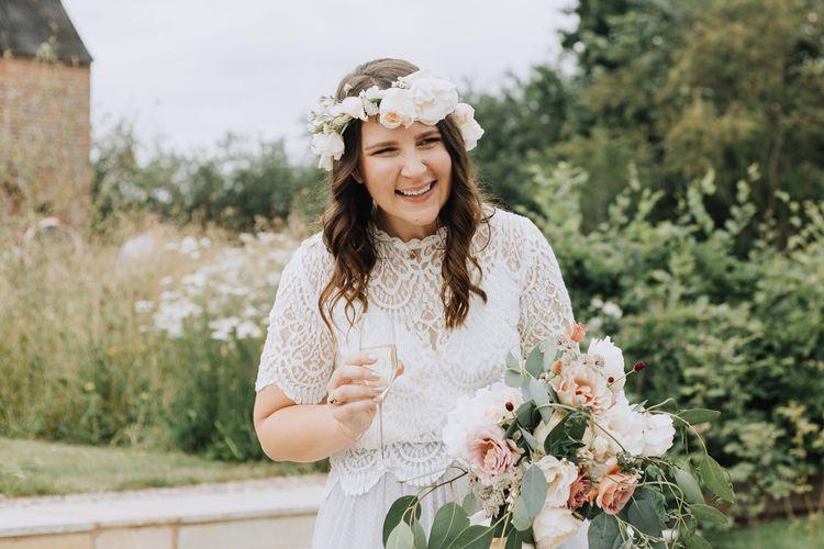 Bride in separates and flower crown smiling at Brickhouse Vineyard