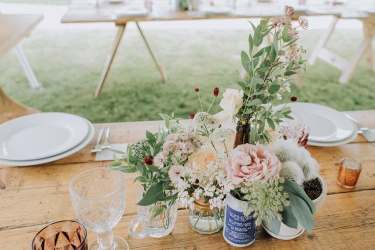 Flowers and foliage in cases at Brickhouse Vineyard wedding
