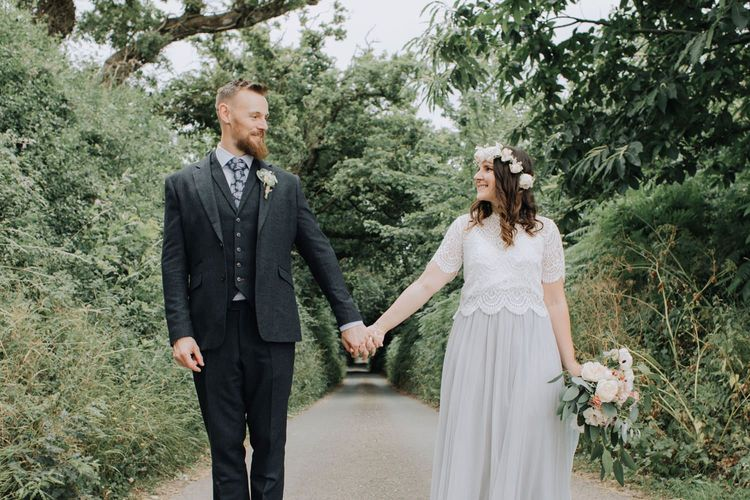 Bride in blue tulle skirt and lace top and groom in three-piece suit