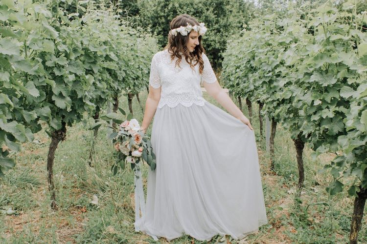 Beautiful bride in blue tulle skirt and lace top
