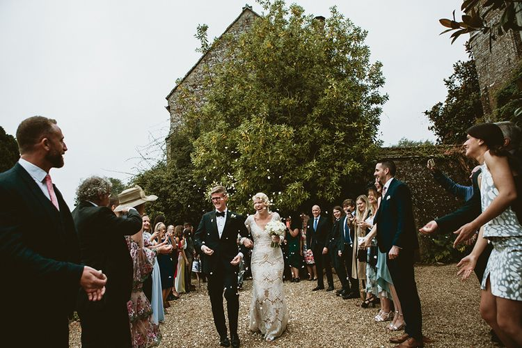 Confetti Moment with Bride in Vintage Style Tara Lauren Wedding Dress  and Groom in Black Tie
