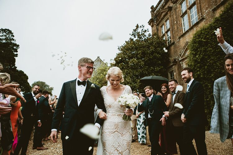 Confetti Exit with Bride in Vintage Style Tara Lauren Wedding Dress  and Groom in Black Tie
