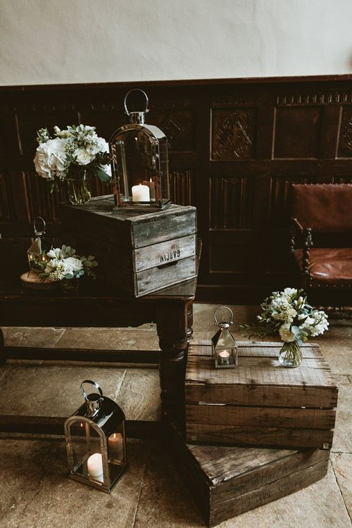 Wooden Crates with Hurricane Lanterns and Wedding Flowers