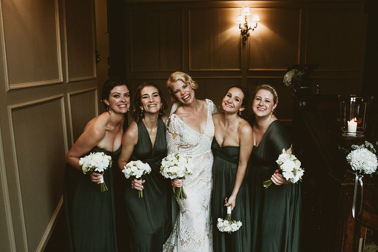 Bridal Party Portrait with Bridesmaids in Forest Green Wrap Dresses and Bride in Vintage Lace Dress