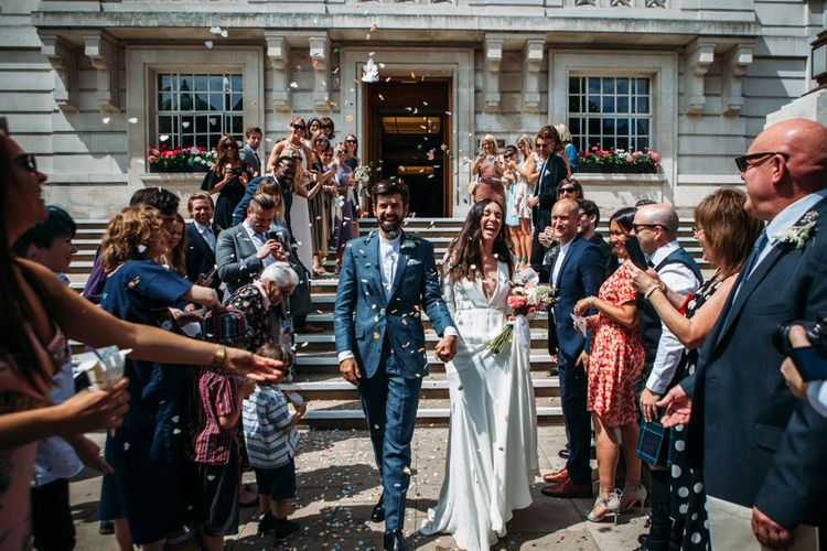 Confetti Exit at Hackney Town Hall   Bride in Reformation Dress   Groom in Blue Richard James Suit   Stylish City Wedding    Joanna Bongard Photography