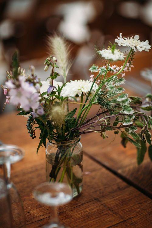Stylish City Wedding at Bow Arts  Courtyard   Marble Stationery, Wild Flowers & Tissue Tassels Decor   Joanna Bongard Photography