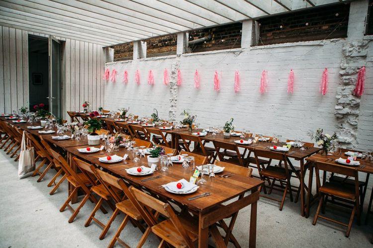 Kinder Egg Wedding Favours   Stylish City Wedding at Bow Arts  Courtyard   Marble Stationery, Wild Flowers & Tissue Tassels Decor   Joanna Bongard Photography