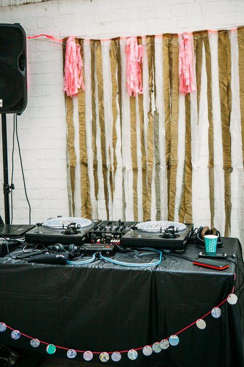 DJ Booth   Stylish City Wedding at Bow Arts  Courtyard   Marble Stationery, Wild Flowers & Tissue Tassels Decor   Joanna Bongard Photography