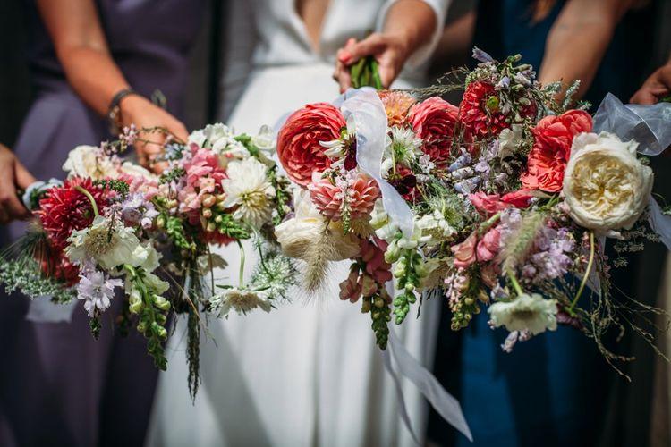 Seasonal Wild Flower Bouquets   Stylish City Wedding at Bow Arts  Courtyard   Marble Stationery, Wild Flowers & Tissue Tassels Decor   Joanna Bongard Photography