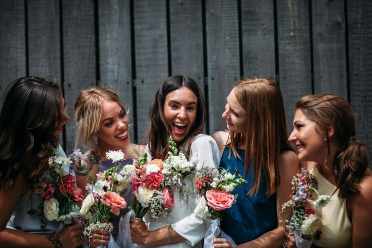 Bridal Party   Bride in Reformation Dress   Bridesmaids in Different Colour Homemade Dresses & Jump-suits   Stylish City Wedding at Bow Arts  Courtyard   Marble Stationery, Wild Flowers & Tissue Tassels Decor   Joanna Bongard Photography