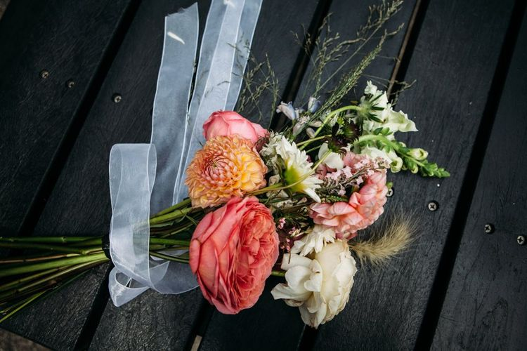 Seasonal Wild Flower Bridal Bouquet   Stylish City Wedding at Bow Arts  Courtyard   Marble Stationery, Wild Flowers & Tissue Tassels Decor   Joanna Bongard Photography