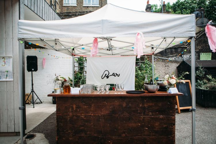 Open Bar   Stylish City Wedding at Bow Arts  Courtyard   Marble Stationery, Wild Flowers & Tissue Tassels Decor   Joanna Bongard Photography