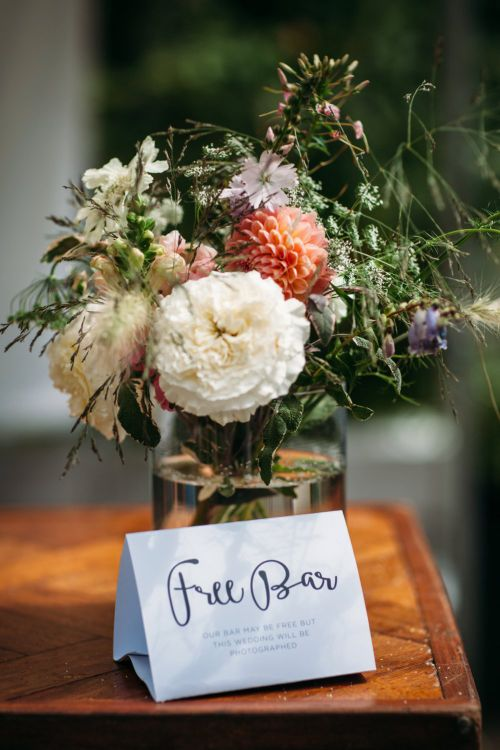 Seasonal Wild Flowers   Stylish City Wedding at Bow Arts  Courtyard   Marble Stationery, Wild Flowers & Tissue Tassels Decor   Joanna Bongard Photography