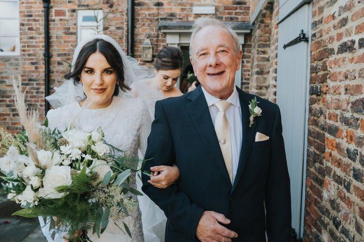 Bride walks to civil ceremony at Hornington Manor in Yorkshire