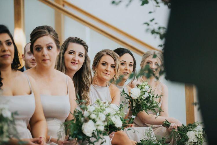 Bridesmaids watch on at civil wedding ceremony