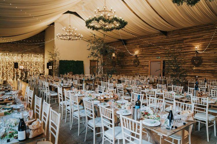 Wedding breakfast decor with foliage chandelier