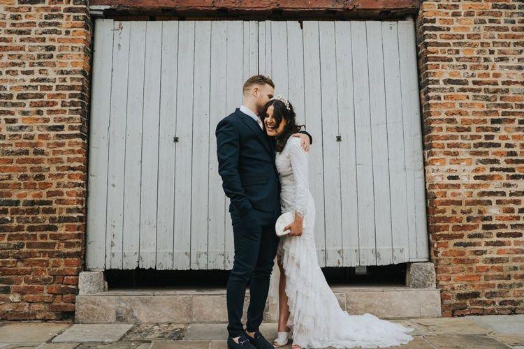 Bride wears bespoke Emma Beaumont wedding dress