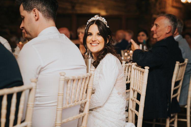 Bride wears bridal crown for wedding reception