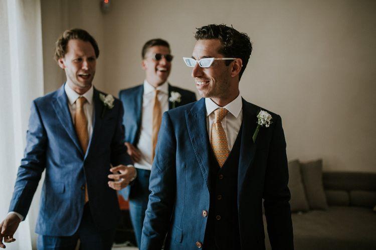 Groomsmen in Navy Suits with Orange Ties