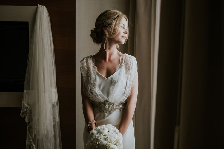 Bride in Halfpenny London Wedding Dress with Lace Overlay and Embellished Belt