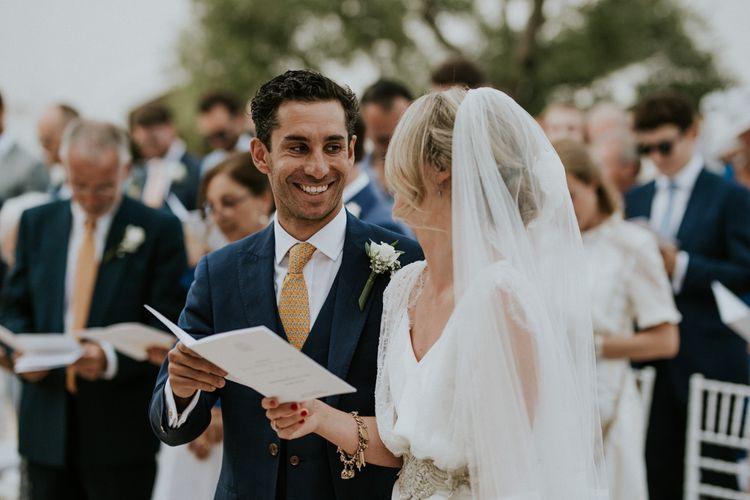 Outdoor Wedding Ceremony with Bride in Halfpenny Wedding Dress  and Groom in Navy Blue Suit