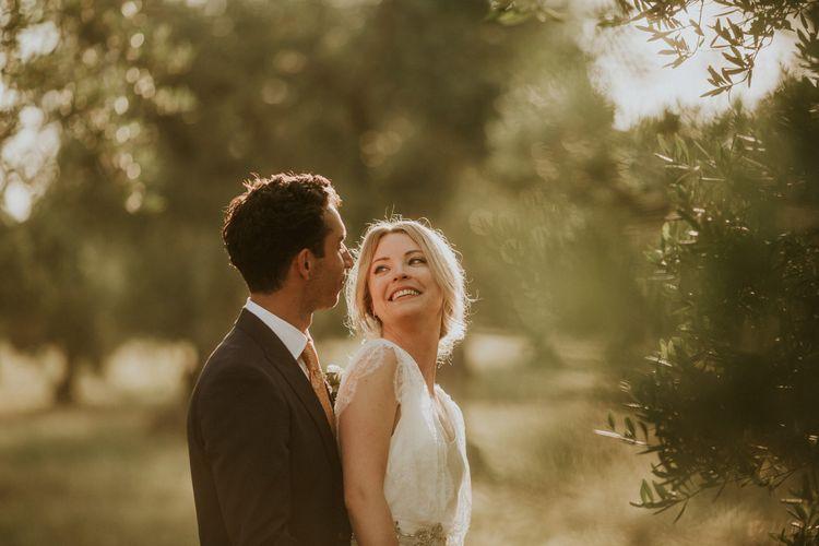 Golden Hour Portrait with Bride in Halfpenny Wedding Dress and Groom in Navy Suit