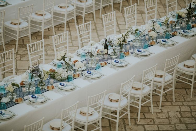 Outdoor Wedding Ceremony with Blue and White Table Runner and Tambourine Wedding Favours
