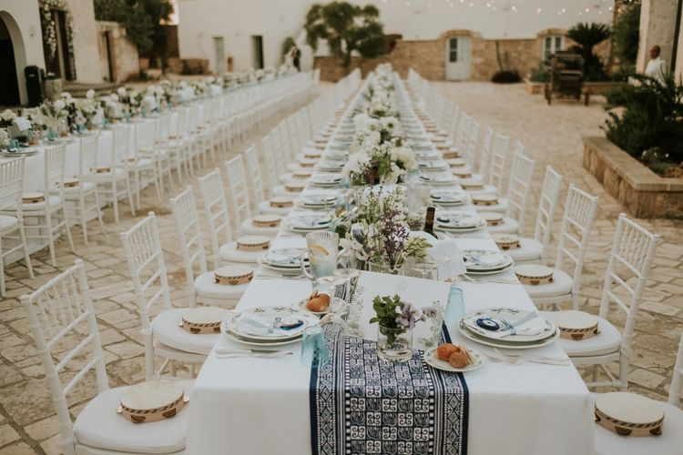 Blue and White Wedding Table Runner and Floral Centrepieces