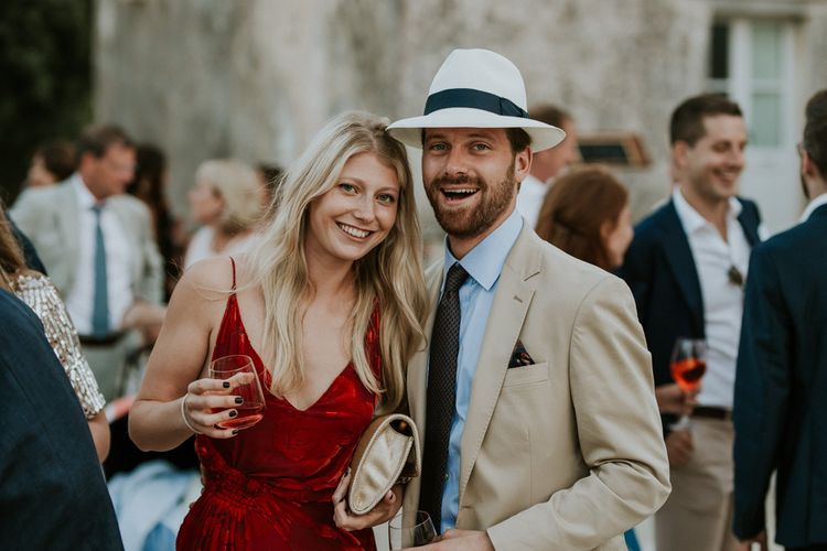 Wedding Guests in Red Dress and Panama Hat