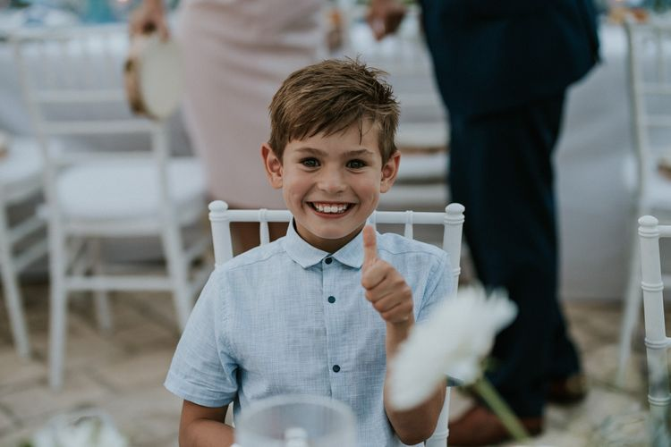 Young Boy Wedding Guests Giving Thumbs Up