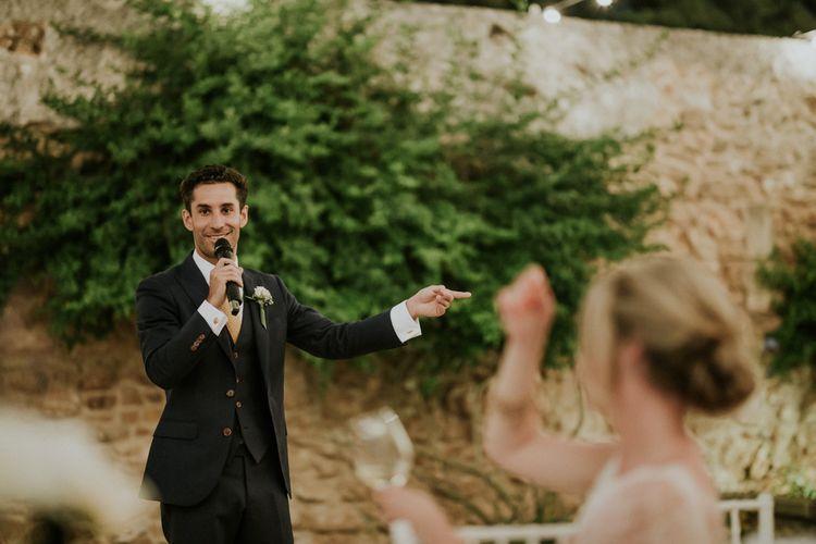Groom in Three-Piece Wedding Suit Giving His Wedding Speech