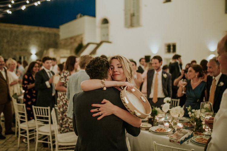 Bride and Groom Hugging at Wedding Reception