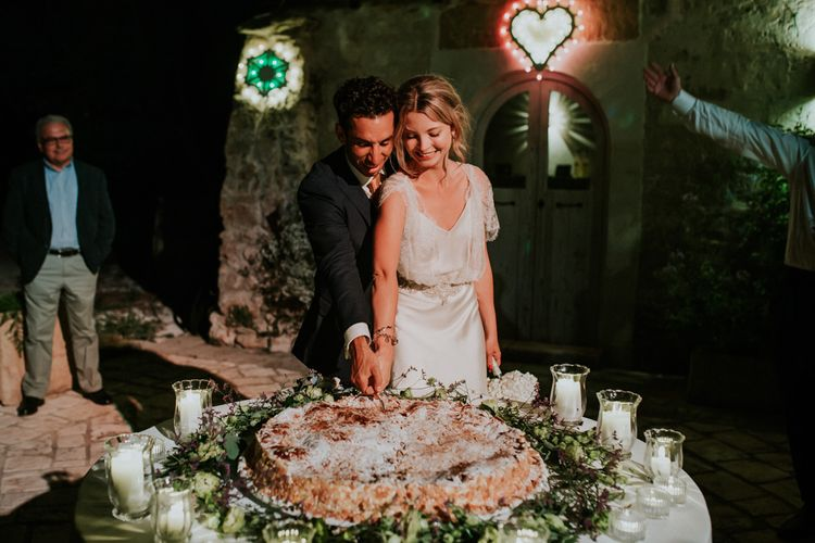 Bride in Halfpenny London Wedding Dress and Groom  in Navy Suit Cutting the Italian Millefoglie Pastry Wedding Cake