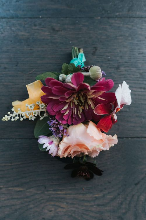 Colourful Buttonhole of Red and Pink Flowers | Meringue Kisses & Colourful Wedding Flowers & Stationery for a London Wedding at The Globe | Miss Gen
