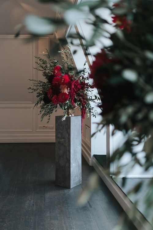 Giant Urn of Red Flowers and Foliage on Grey Plinth | Meringue Kisses & Colourful Wedding Flowers & Stationery for a London Wedding at The Globe | Miss Gen