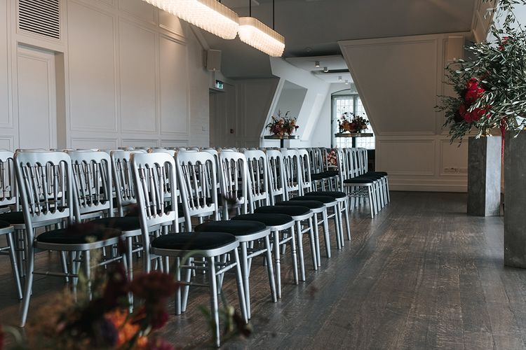 Wedding Ceremony at The Swan at The Globe | Giant Urns of Red Flowers and Foliage on Grey Plinths | Meringue Kisses & Colourful Wedding Flowers & Stationery for a London Wedding at The Globe | Miss Gen
