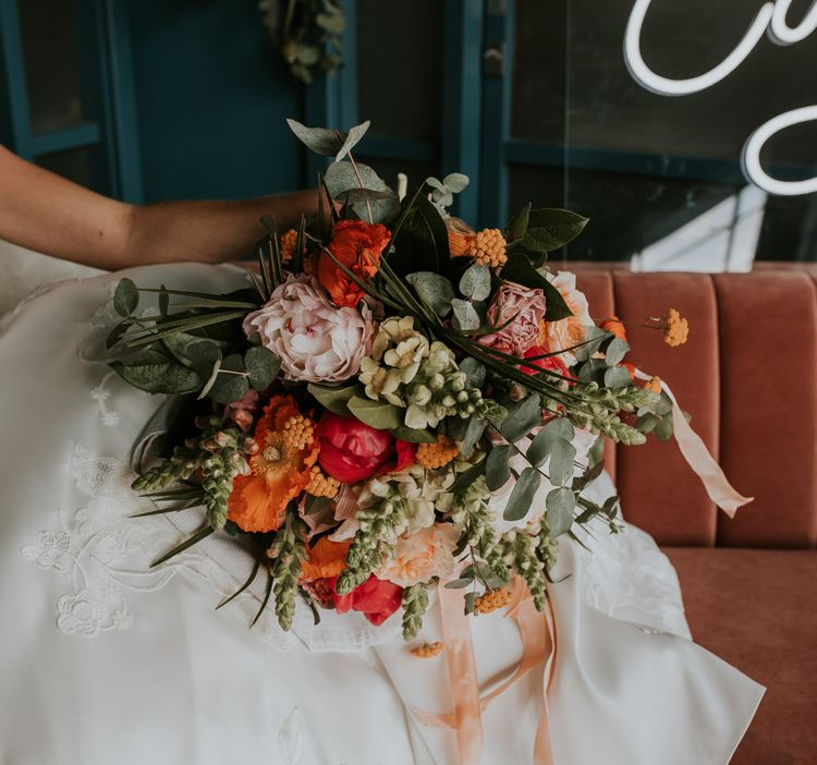 Bright Bridal Bouquet with Foliage and Living Coral Flowers