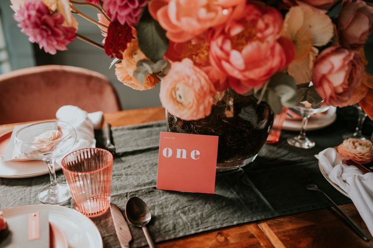 Living Coral Wedding Flowers, Statement Table Number Signs and Coloured Goblet Table Decor